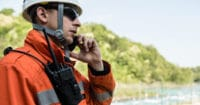 Search and rescue worker communicates with team during an outdoor rescue mission.